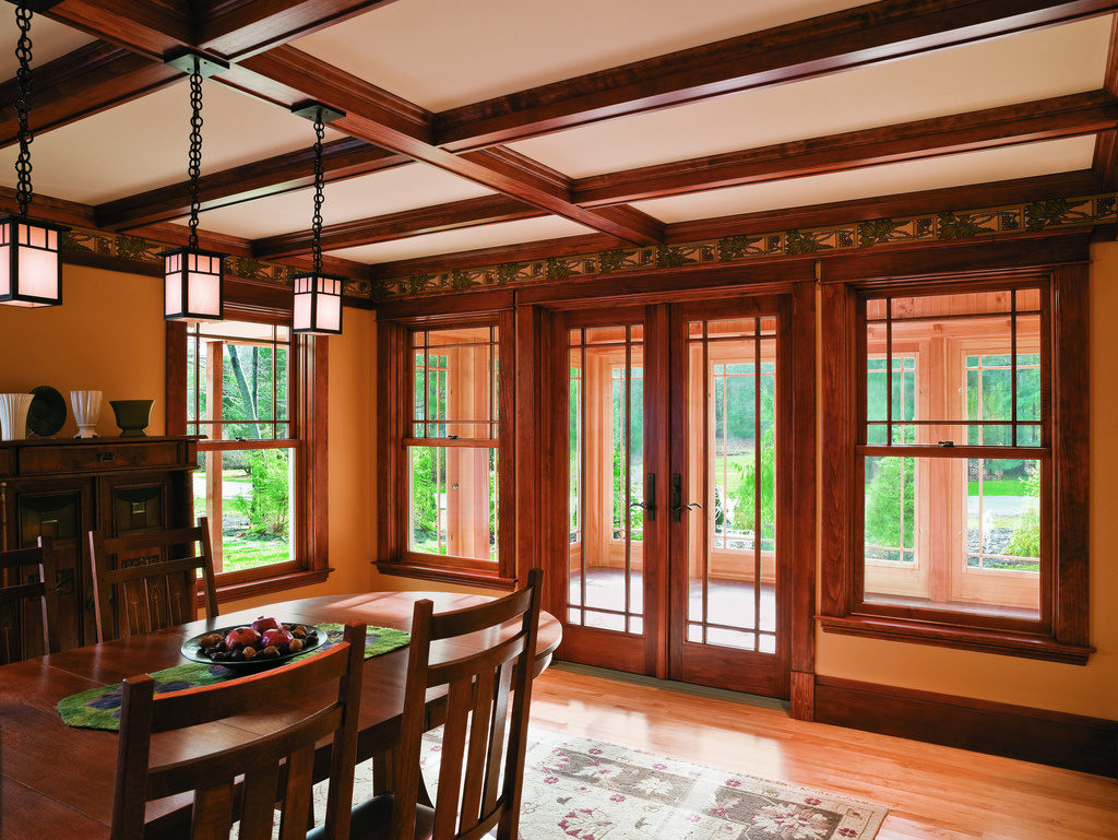 A-Series Double-Hung Windows, Oak Interior, Prairie Grilles Upper Sash Only. Frenchwood Hinged Patio Door, Oak Interior, Yuma Hardware in Distressed Bronze Finish, Prairie Grilles